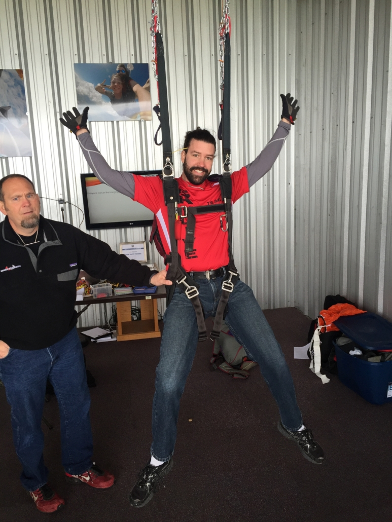 Sitting in the solo skydive jump school training harness.